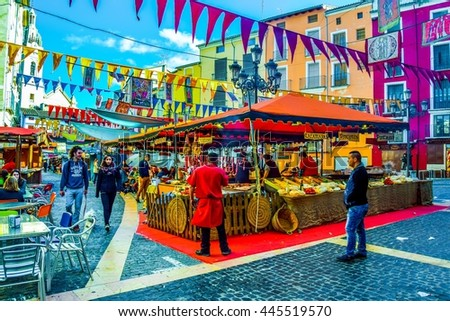 XATIVA, SPAIN, JANUARY 2, 2016: merchant are trying to sell their products during traditional marketplace on a square in the spanish city xativa  #445519570