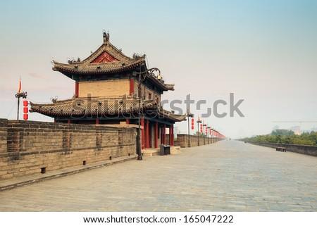 xi\'an ancient city wall with tower at dusk , China.