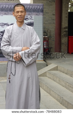 XIAN - MAY 1: A monk meditating in the Giant Wild Goose Pagoda on May 1, 2011, in X'ian, China. The pagoda holds sutras and figurines of the Buddha brought to China from India by Xuanzang.