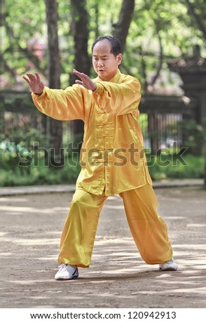 XIAN-MAY 21. Chinese man practice Tai Chi. Tai Chi Chuan means 'Supreme Ultimate Fist' and is a popular martial art in China practiced for self defense and health benefits. Xian, May 21, 2009.