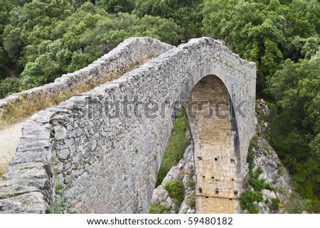 XII century medieval bridge, in Tortella, Catalonia