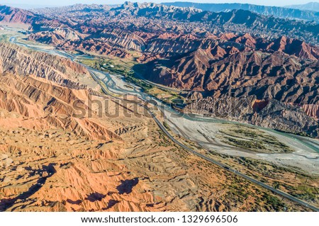 Xinjiang China. National Geopark Danxia Landform. China travel famous natural exotic landscape. Sandstone towers large canyon dry desert valley #1329696506
