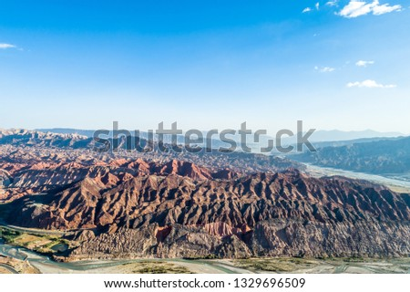 Xinjiang China. National Geopark Danxia Landform. China travel famous natural exotic landscape. Sandstone towers large canyon dry desert valley #1329696509