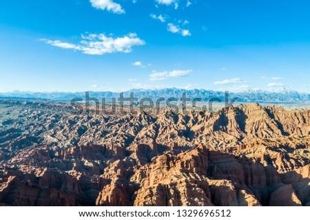 Xinjiang China. National Geopark Danxia Landform. China travel famous natural exotic landscape. Sandstone towers large canyon dry desert valley #1329696512