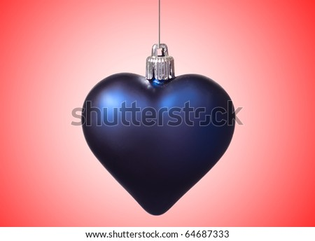 xmas big blue heart on red background - stock photo