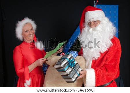 Xmas, Christmas time, santa claus and woman ready for delivering presents.  Holiday, happiness, peace concept.