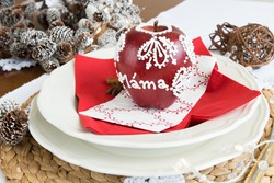 Xmas decoration pattern.Sweet topping a mixture of well-beaten egg whites and sugar, typically used as a topping for desserts, title Mama- mum /Christmas apple decoration, step by step tutorial