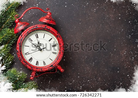 Xmas greeting card. Christmas background with snow fir tree and alarm clock. View from above with space for your greetings #726342271