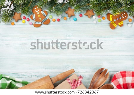 Xmas greeting card. Christmas background with snow fir tree and gingerbread cookies. View from above with space for your greetings - Shutterstock ID 726342367