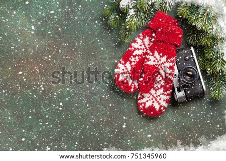 Xmas greeting card. Christmas background with snow fir tree, camera and mittens. View from above with space for your greetings or photo #751345960