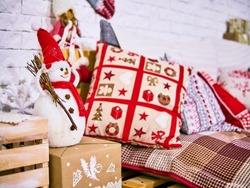 Xmas pillows with cover, Snowman and stars decor. New Year's card scenery. Christmas concept.