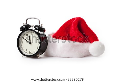 xmas red hat and alarm clock on white background