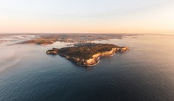 XXL panoramic sunrise aerial drone view of North Head, a headland in Manly and part of Sydney Harbour National Park in Sydney, New South Wales, Australia. Manly and Northern Beaches in background.