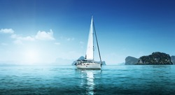 yacht and blue water ocean