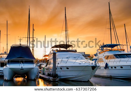 Yacht and boats docking at the marina in the evening, Phuket, Thailand #637307206