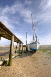 Yacht at low tide in Arcachon bay (France)