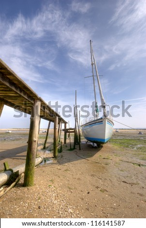 Yacht at low tide in Arcachon bay (France) - stock photo