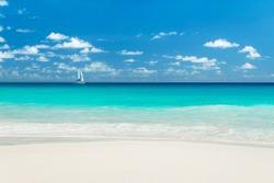 Yacht at tropical sandy beach. Anse Georgette, Praslin island, Seychelles - vacation background
