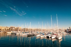 Yacht harbor on a beautiful clear sky and reflecting water
