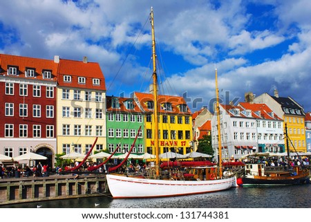 Yacht in Copenhagen sea front in summer. Nyhavn is old waterfront and canal district
