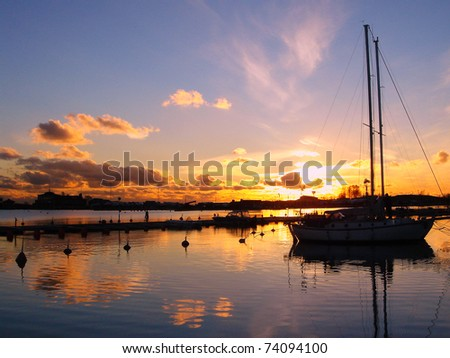 Yacht in the early evening. Sailboat On Sunset. Beautiful idyllic picture.