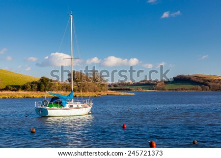 Yacht moored off the quay at St Germans Cornwall England UK Europe
