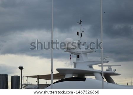 yacht navigation locator. Felling a yacht against a background of gray clouds #1467326660