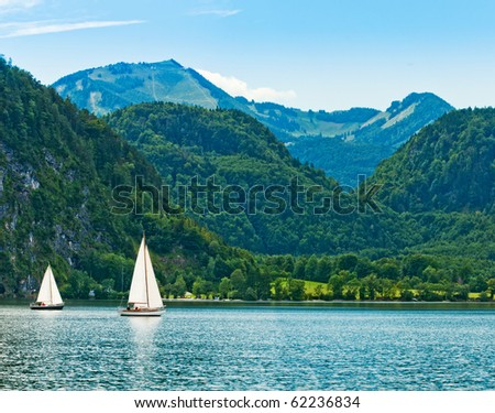 Yacht on a blue alpine lake. Salzkammergut. Austria