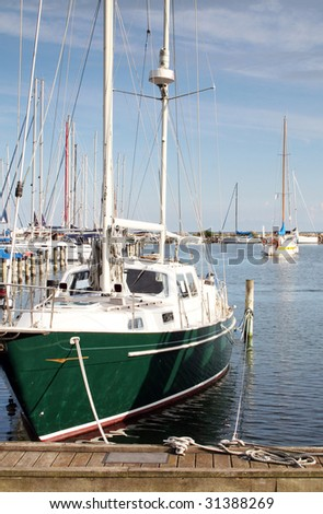 yacht or motor boat at harbor moored at jetty in denmark