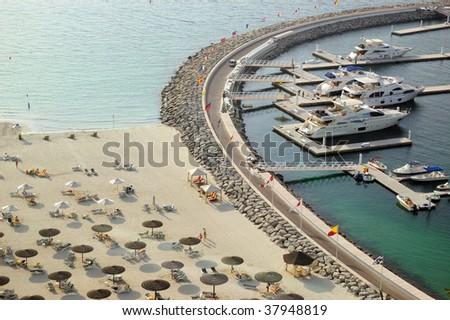 Yacht parking near luxury hotel and beach, Dubai, UAE