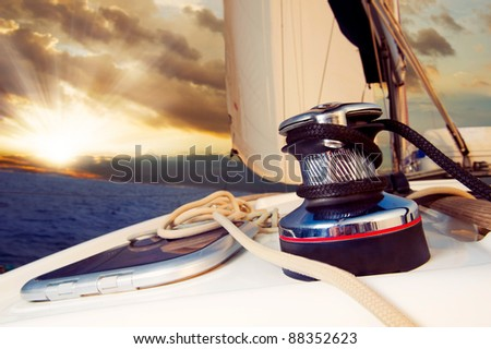 Yacht Sailing against sunset.Sailboat.Travel