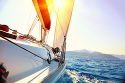 Yacht Sailing against sunset. Sailboat. Yachting. Sailing. Travel Concept. Vacation