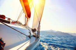 Yacht Sailing against sunset. Sailboat. Yachting. Sailing. Travel Concept. Vacation
