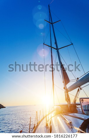 Yacht Sailing against sunset. Sailboat. Yachting. Sailing Travel Concept Vacation