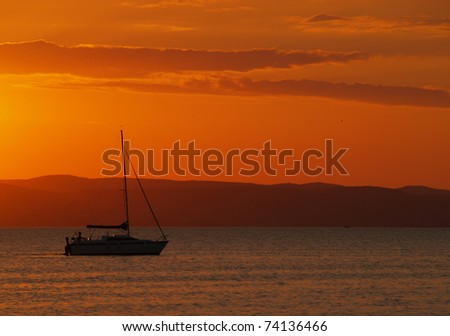 Yacht sailing in Balaton in sunset
