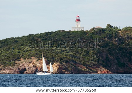 yacht sailing near La Chiappa lighthouse close to Porto Vecchio, Corsica - France