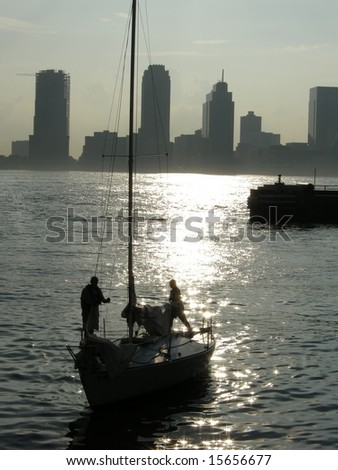 yacht silhouette, view from manhattan, new jersey in background