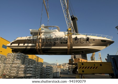 yacht transport at port with crane and cable