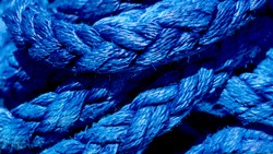Yachting ropes or lines in pile, blue color texture, synthetic fibres
