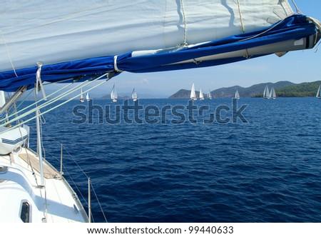 Yachting. Sailing toward in Mediterranean Sea - stock photo