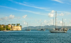 Yachts anchored in Fort De France harbor with fortress in the background, Fort-De-France, Martinique,  French overseas department