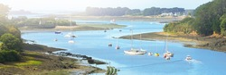 Yachts and boats anchored on mooring in Élorn river. Panoramic aerial view. Summer landscape. Brittany, France. Leisure activity, recreation theme