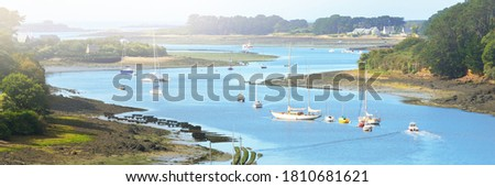 Yachts and boats anchored on mooring in Élorn river. Panoramic aerial view. Summer landscape. Brittany, France. Leisure activity, recreation theme Stok fotoğraf ©