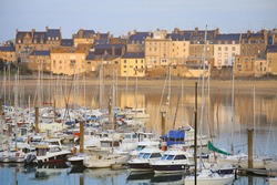 Yachts and houses with it's reflection in the port of Saint Malo, Normandy, France