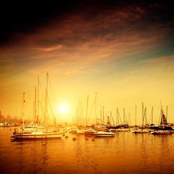 Yachts and pier at dusk