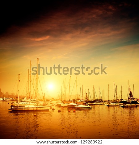 Yachts and pier at dusk