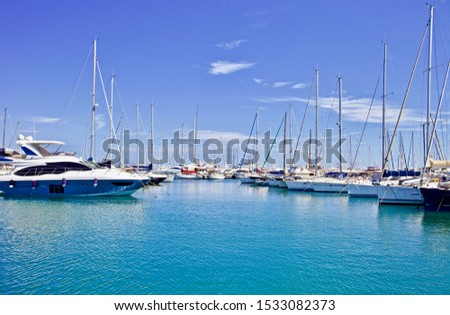 yachts and speed boats at harbor. yachts moored in the port. Ocean Coast pier. High class lifestyle. Yachting. Expensive toys. Sea ​​transport. Journey. Yachting sport. Expensive yachts at the pier