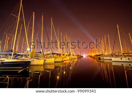 Yachts at a wharf - stock photo