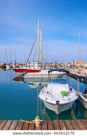 Yachts in Latchi harbour, Cyprus, on a bright day #663652570