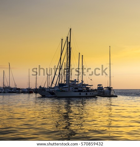 Yachts in the Mediterranean port in Croatia. Wonderful colors of sunset.